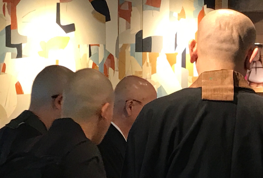 monks in starbucks